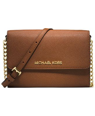 Ready for an adventure? Whether you're trotting the globe or exploring the city streets, this Michael Michael Kors crossbody will be your first-class compatriot. | Imported | Saffiano leather | Adjust