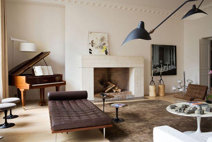 Monaco interior architect team Humbert & Poyet. A stunningly simple fireplace, graphic artwork, classic furnishings by the likes of Eero Saar // BROOKE TESTONI PINTEREST