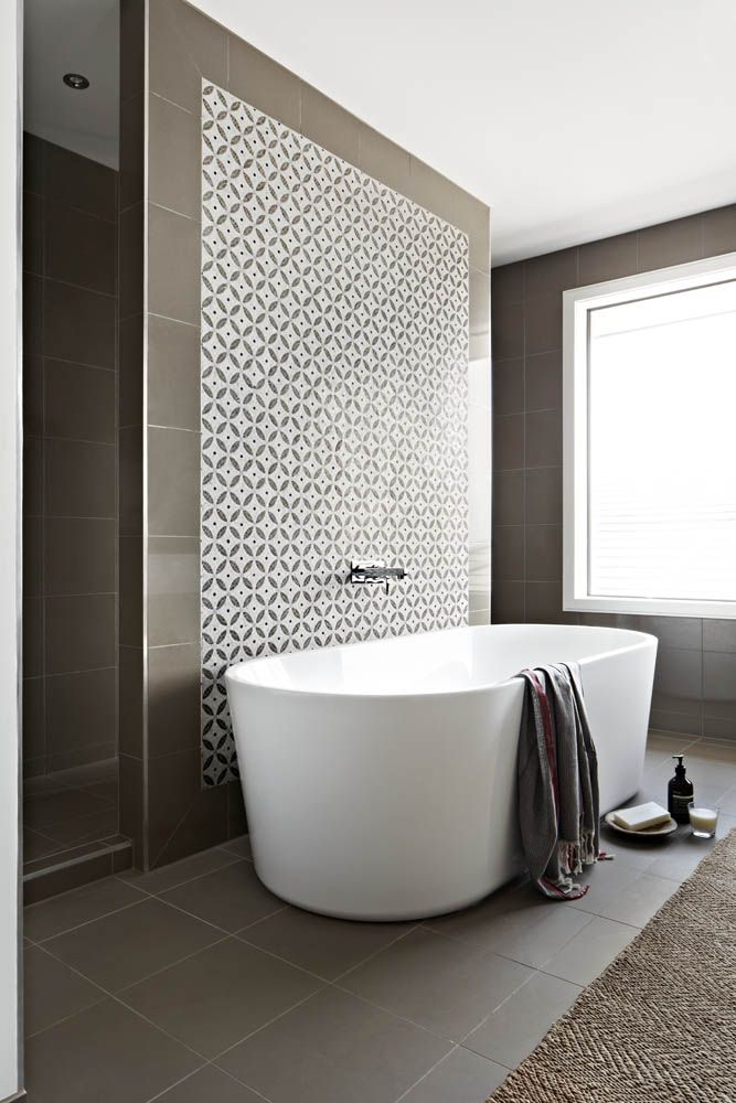 Arkee projects for Orbit Homes.  Designs for Living Furniture and styling.  Aspire Home.  Ensuite with walk through shower, freestanding bath and stone mosaic  Visit www.arkee.com.au for more photos of the Aspire home.   Arkee Creative, we love the blank page.