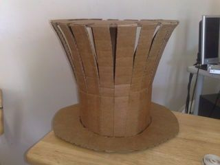 DIY: Cardboard Mad Hatter Hat Covered with fabric this comes out surprisingly awesome! -RB | followpics.co