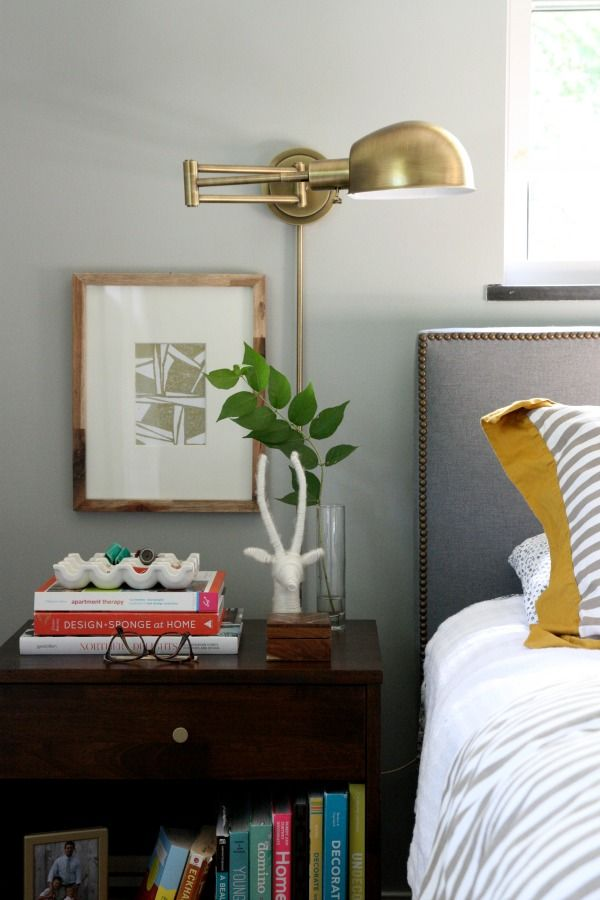Livable #bedroom design with #brass sconce and shelf #storage