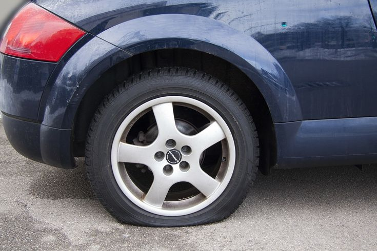 aaa roadside service calls increasing car with flat tire