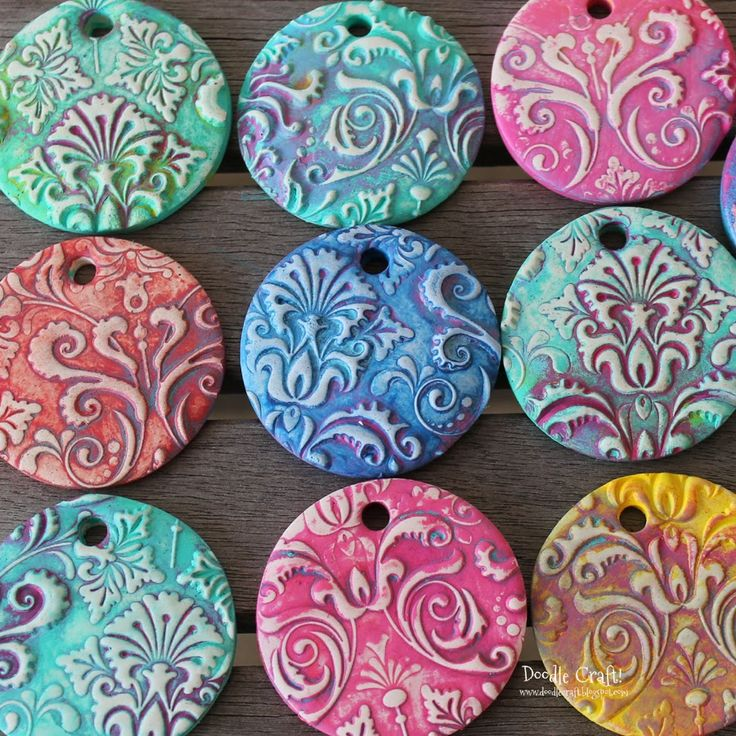 Doodlecraft: Damask Polymer Clay Pendants!  SUCH an amazing technique, might use this for making large buttons...