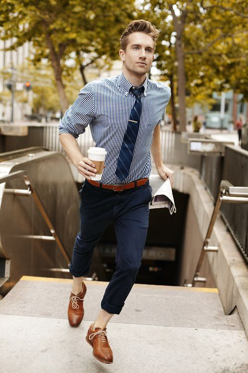 On the go: blue on blue. Tie, rolled pants, checked shirt, brown leather oxfords.
