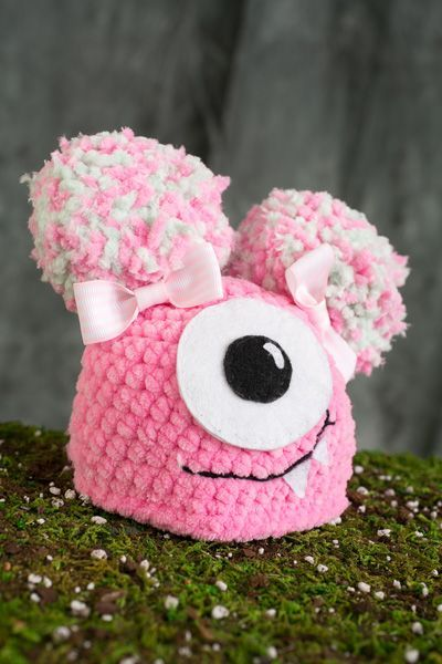 Newborn Fuzzy Monster Hat - This adorable newborn-sized hat features two little pom-pom ears and a goofy little monster face, complete with toothy grin. The Fuzzy Monster Hat is an easy pattern and is perfect for crochet novices who want to make a cute Halloween-themed baby gift. from the October 2015 issue of I Like Crochet