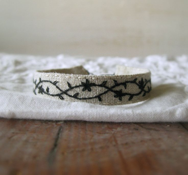 Rustic Floral Jewelry - Hand Embroidered Cuff Bracelet - Black Vine on Natural Linen - Gift For Her - Unique Textile Jewelry - Handmade by Sidereal on Etsy https://www.etsy.com/listing/212054689/rustic-floral-jewelry-hand-embroidered