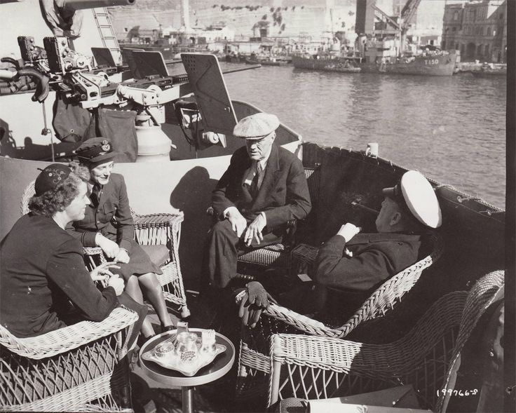 President Franklin D. Roosevelt and Prime Minister Churchill aboard the U.S.S. Quincy in Grand Harbour, Malta, on February 2. Anna Roosevelt Boettiger, left, and Sarah Churchill Oliver accompanied their fathers on the long journey to the Crimea.