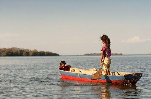 Children rowing to school near Jicaro Island Ecolodge in Nicaragua.