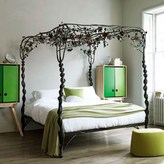 Secret garden bedroom Twisted steel and copper bed celebrates all that is wild and magical about nature. Brightly modern side tables add a counterpoint.