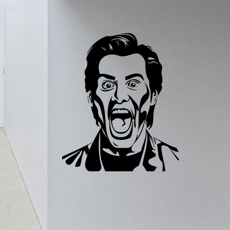 Jim Carrey Portrait Wall Decal  This unique Jim Carrey Portrait Wall Decal is impossible to ignore wherever it is placed. Featuring the famous slapstick comedian in a classic, grotesque expression, this design perfectly captures Carrey's wild energy. Bold and quirky, this design is not for the faint of heart.