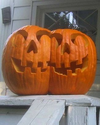 decoration a fascinating halloween party garnish for outdoor with a carving pumpkin in twin faced stand on wooden stair