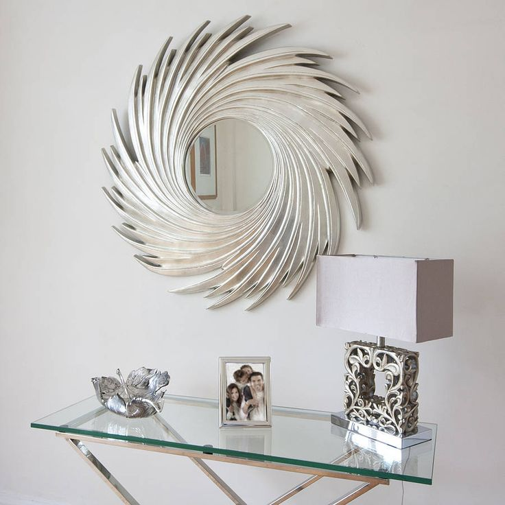 This elegant round silver swirl wall mirror is made of wood with high quality resin and finished in silver. £245.00
