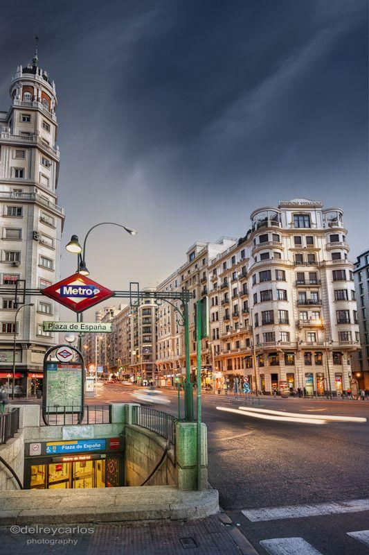 Night scene of Madrid with subway station. by Carlos Ramírez de Arellano del Rey