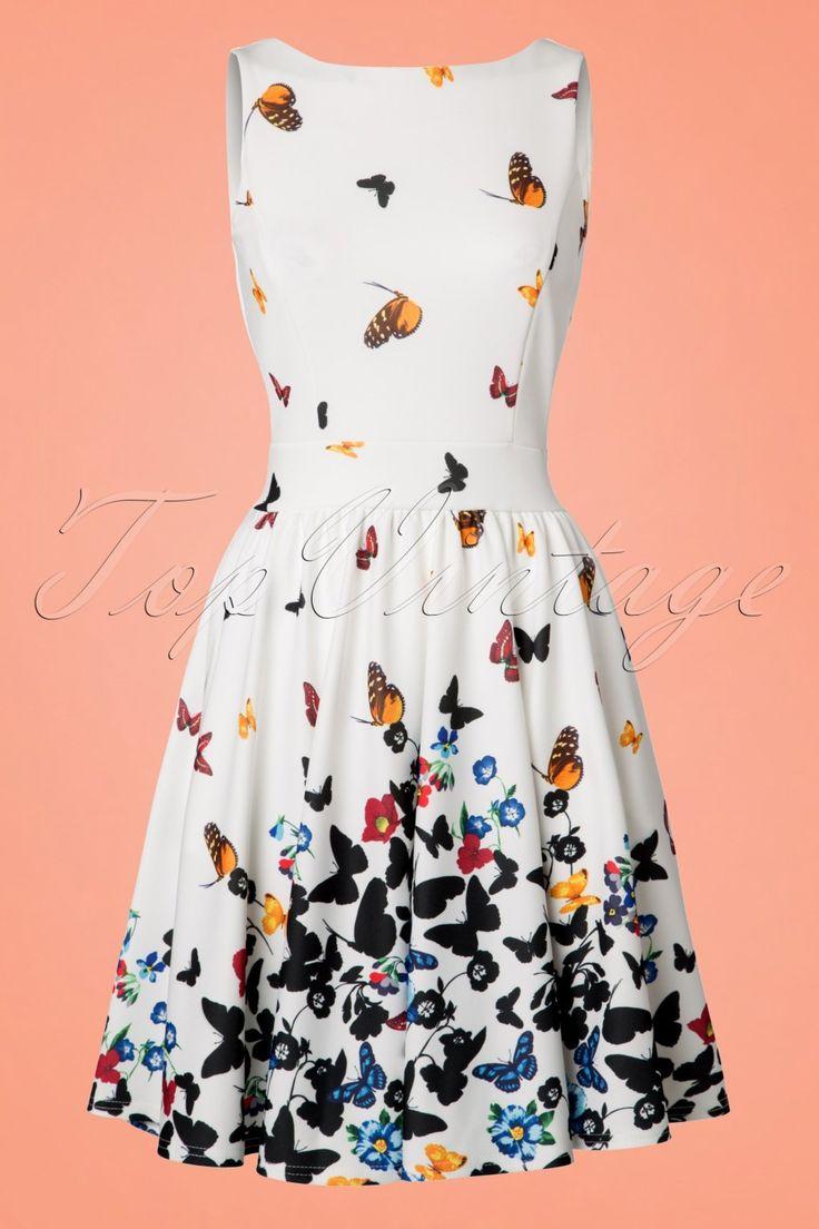 Van een rups naar een vlinder in deze 50s Tea Butterfly Swing Dress!Spreid je vleugels en bereid je voor om te vliegen! Nou ja... figuurlijk dan ;-) Deze dress is flirty en feminine dankzij haar ronde halslijn, subtiele V-rug en vaste strikbanden voor een elegant, vrouwelijk fifties silhouet, oh la la. Uitgevoerd in een soepel vallend, glad, ivoorwit stofje met een lichte stretch en een prachtige, romantische vlinder- en bloemenprint. Heb jij ook al vlinders in je buik van deze jurk?&nbsp...