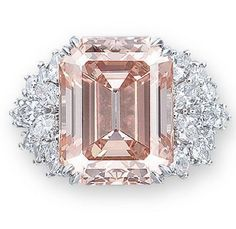 Harry Winston: RARE COLOURED DIAMOND AND DIAMOND RING, BY HARRY WINSTON Set with a rectangular-shaped orangy pink diamond weighing 12.93 carats, to the marquise-cut diamond shoulders, mounted in platinum