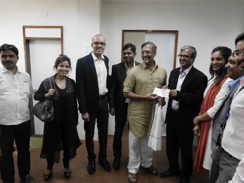 Technip team hands over cheque to Nana Patekar and Naam Foundation