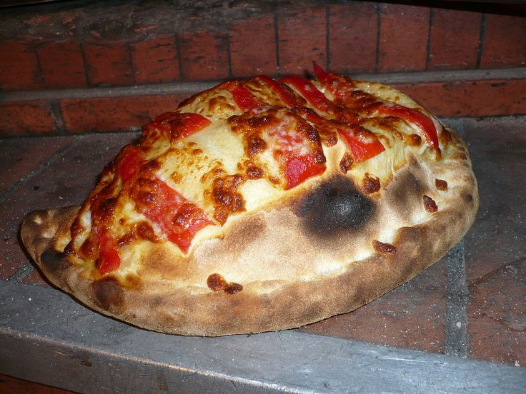 Baked panzerotti with tomato and mozzarella cheese