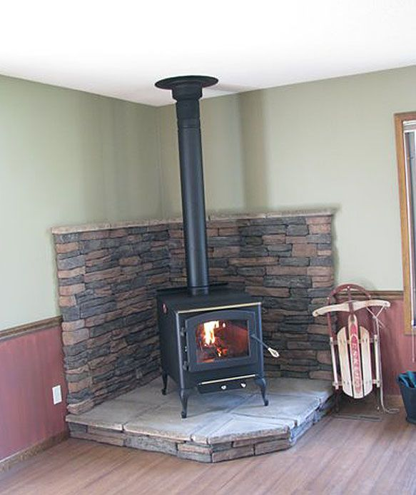 wood stove with mantls | Englander Wood stove with site-built hearth and HT insulated chimney