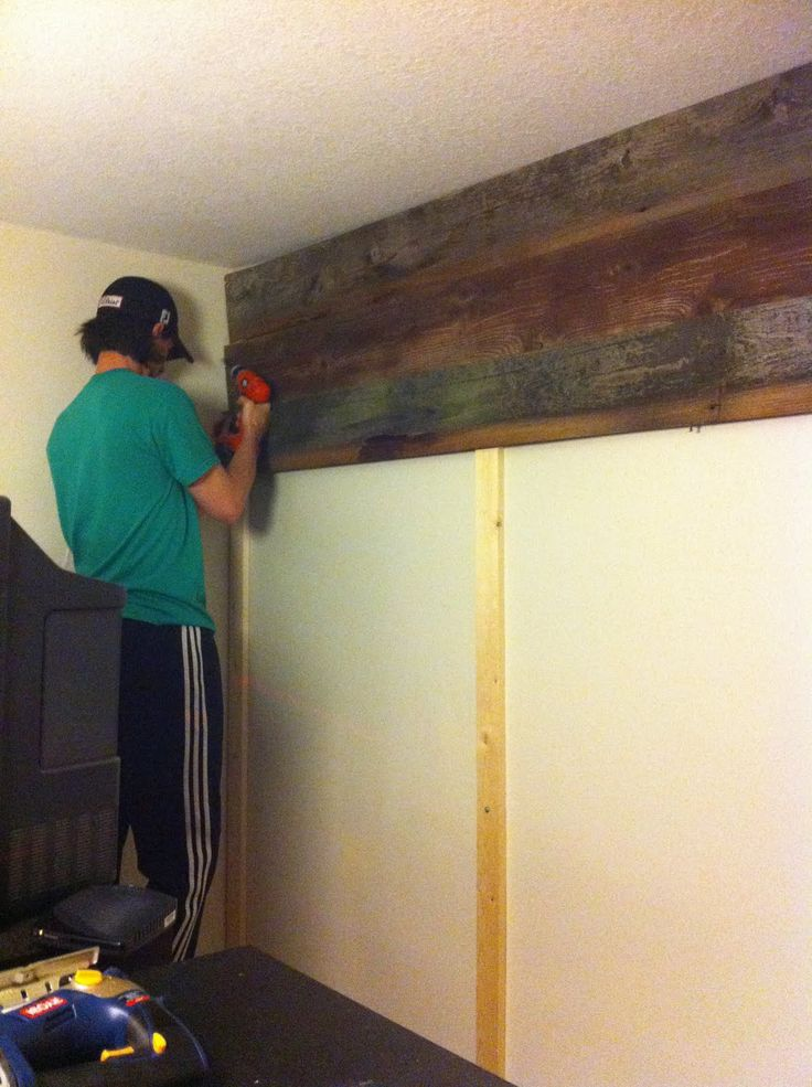 Use pieces to attach wood to instead of putting a bunch of holes in the wall