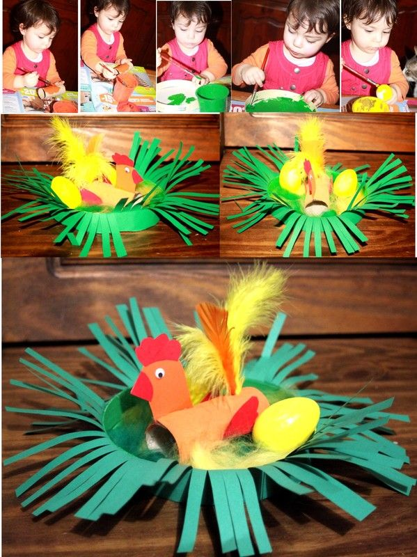 een kip op het nest(   gemaakt van karton, wc rolletje , strookjes papier...én veertjes