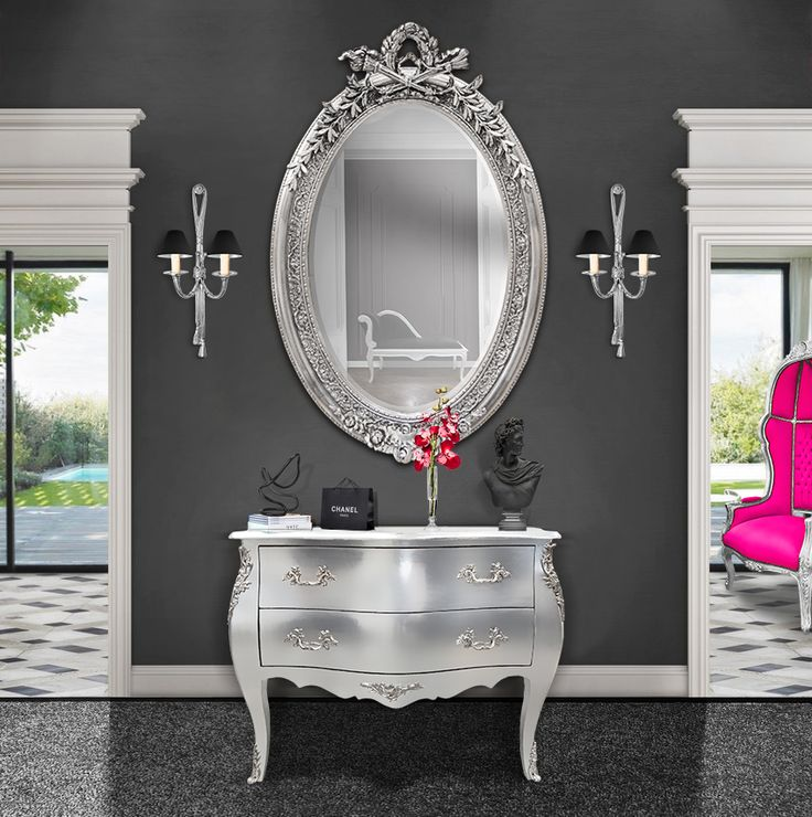 [EN] Silver leaf baroque chest of drawers with silver mirror, silver bronze wall light and baroque porter's chair fuchsia and silver.   [FR] Commode 2 tiroirs baroque avec grand miroir argenté, appliques en bronze argenté et fauteuil carrosse fuchsia et bois argenté à la feuille.  #Applique #Walllight # #Interior #Interiors #Baroque #LouisXV #Silver #Argent #Homedecor #Decoration #French #France #Rococo #Fauteuil #Armchair #Commode #Chestofdrawers #Bronze
