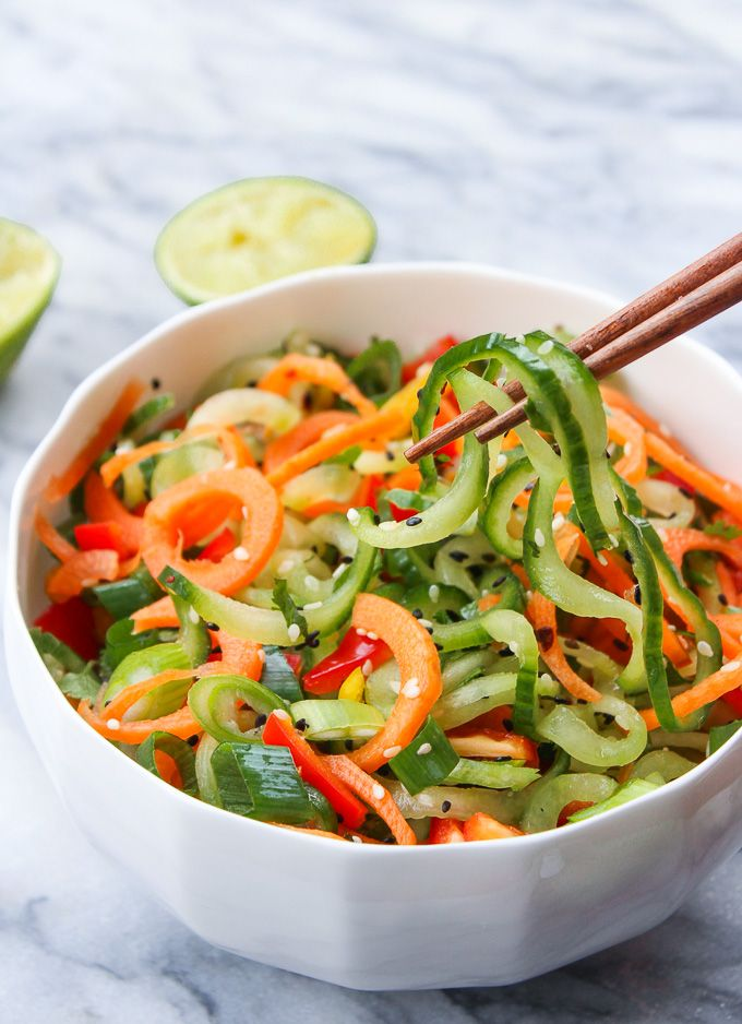Raw Asian Cucumber Sesame Salad: Bright flavors and crunchy textures! Paleo, vegan, and low FODMAP. Spiralized carrots and cucumber