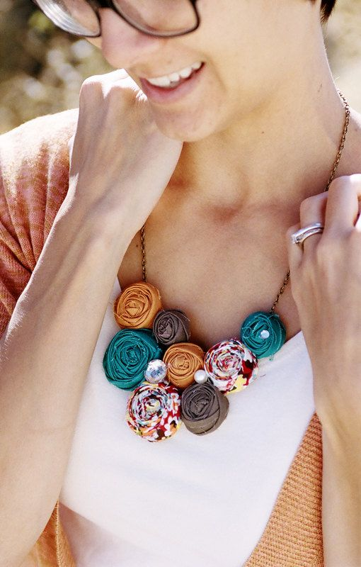 Different, but i like it!!! dressy casual statement necklace.     Lee Lynn    Teal Orange and brown  rosette bib by lovestitched, $38.99