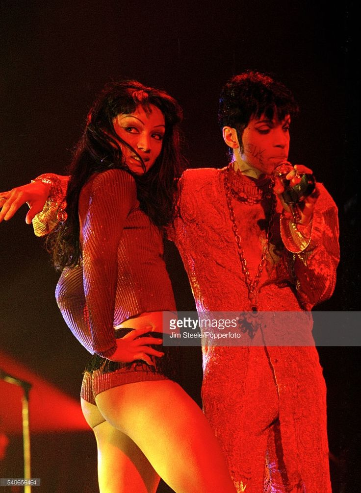 Prince and Mayte Garcia performing on stage at Wembley Arena in London, circa March 1995.