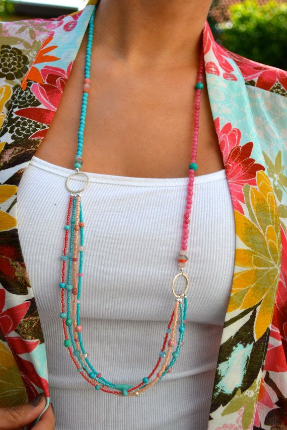 Just in time for summer, this necklace is a gorgeous combination of coral pink and turquoise seed beads, variations of czech glass beads,