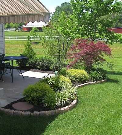 use curved landscape border, fill in with dwarf shrubs, ground cover, steeping stones and mulch/rock @ its-a-green-life