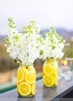Lemon Filled Mason Jars & Flowers maybe dye the lemons different colors for Alice party??
