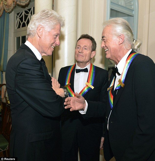 Best pals: Former U.S. President Bill Clinton, left, shares a joke with Jimmy Page, right, and and John Paul Jones from Led Zeppelin