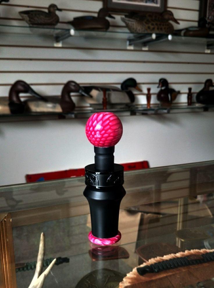 Real Calls duck call. Original flat black acrylic, with Pink Juma snake tips  Patented insert. www.duckbandbrand.com