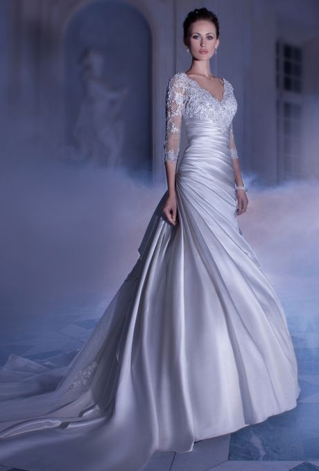 Brides: Demetrios - Sposabella. Satin, A-line gown with a V-neck, 3/4 length sleeves and asymmetrical pleated wrap waist and skirt. Upper bodice and sheer sleeves are embellished with beaded Venice lace. Back features a low V with lace and beaded lace over tulle underlay on chapel train.