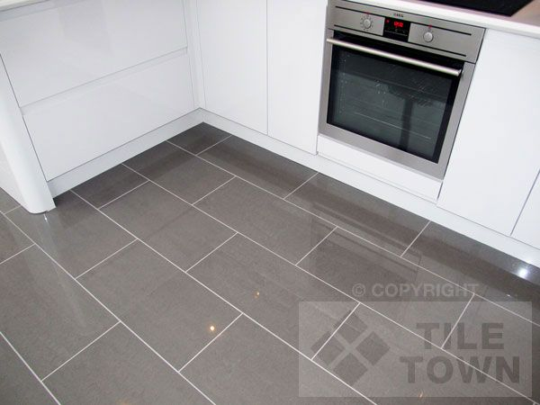 Rooms with gray tile floors lounge dark grey porcelain for Dark tile kitchen floor