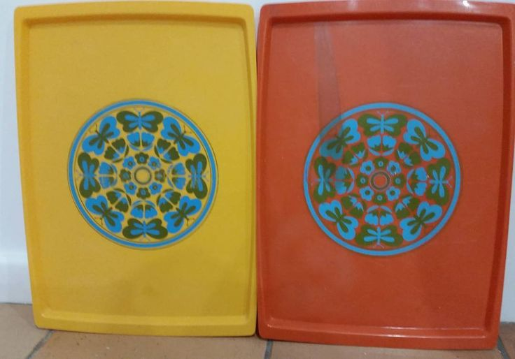 """""""I have a pair of retro plastic serving  trays..the orange on does have like a stain on it and both have scuff marks on it..still very very retro cool…"""""""