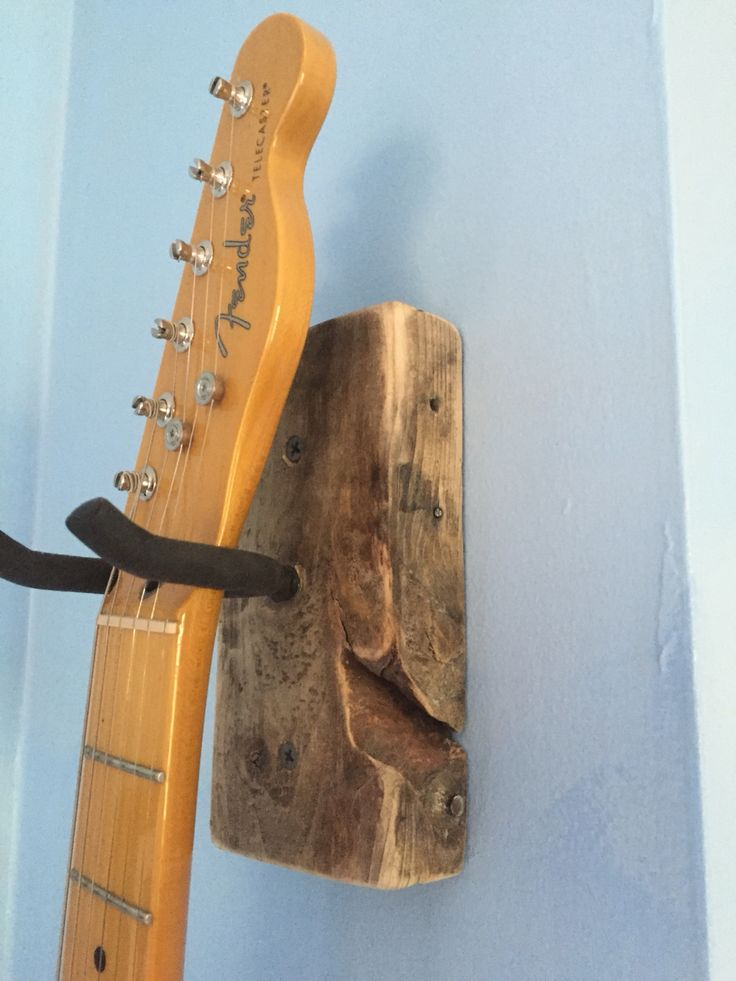 DIY Guitar Hanger  First attempt turned out ok. Hanger from Home Depot and leftover pallet wood. I'll definitely be making more of these.