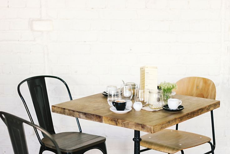 white brick wall | table | coffee | drinks | interior | cafe | SKØG Urban Hub | Brno