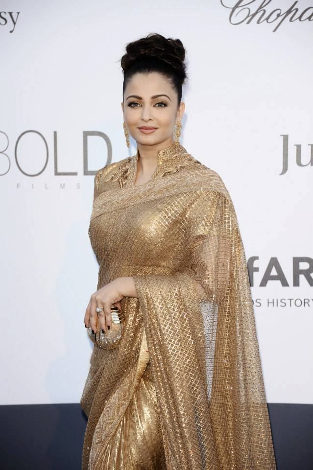 Aishwarya Rai wearing this gorgeous gold Sari at Cannes 2013