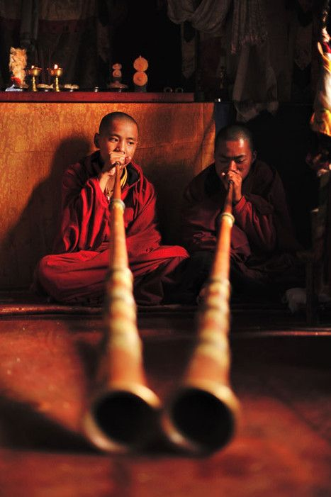 Two monks in a prayer ceremony. Bhutan is an intensely Buddhist country, and it's a great honor to have a monk in the family.See the complete Bhutan itinerary