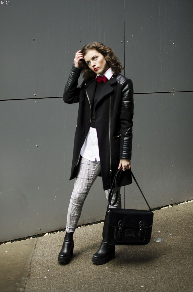Full outfit with red denim bow tie, white shirt, black sweater, black jacket, black bag and grey pattern pants. Featured by a vegan blogger at www.donnaiveh.com