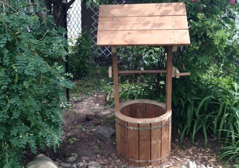 Wooden wishing well made by Robert Almond