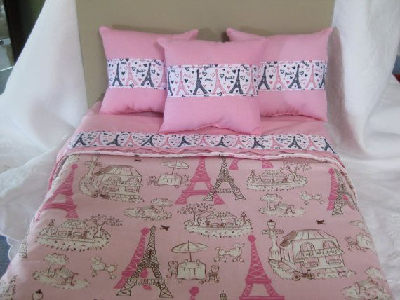 "Cute 5 Piece American Girl 18 Doll Bedding Paris by CuddleBugBaby, $30.00. This American Girl 18"" doll bedding is cute Paris theme with pink pillows and topsheet. There are three pillow with Eiffel tower trim. There is a reversible bedspread with a Paris theme. If your little girl loves American Girl this set is a must. . I have added decorative stitches all along the bottom edge. This set is for an 18 inch doll."