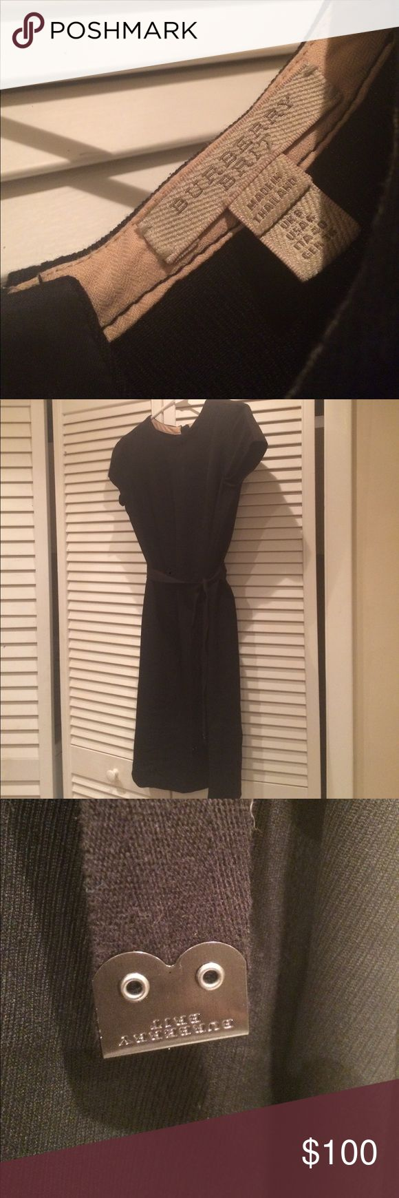 """Burberry Brit 100% wool black with pockets and belt 29"""" long from under arm . Cap sleeves. Timeless ❤️❤️ Burberry Brit Dresses Midi"""