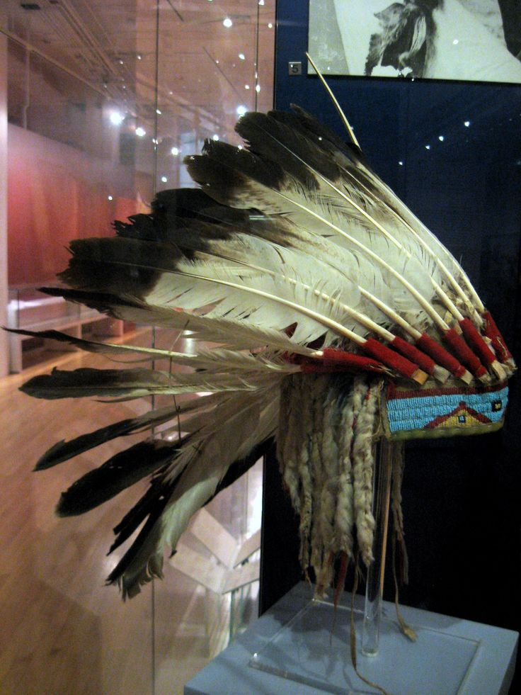 """1875 Lakota War bonnet belonging to Sitting Bull at the Royal Ontario Museum, Toronto - From the curators' comments: """"The war bonnet embodies sacred powers and also represents it's owners war achievements. The feathers symbolize the eagle carrying prayers to the Creator; their radiating form makes a visual reference to the sun."""""""