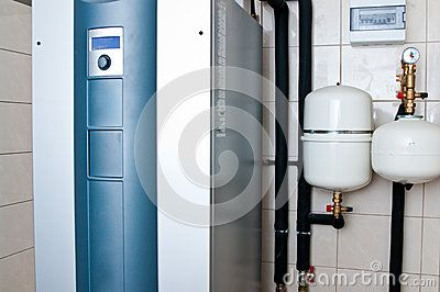 Modern geothermal furnace unit at home setting. Renewable energy for homes concept.