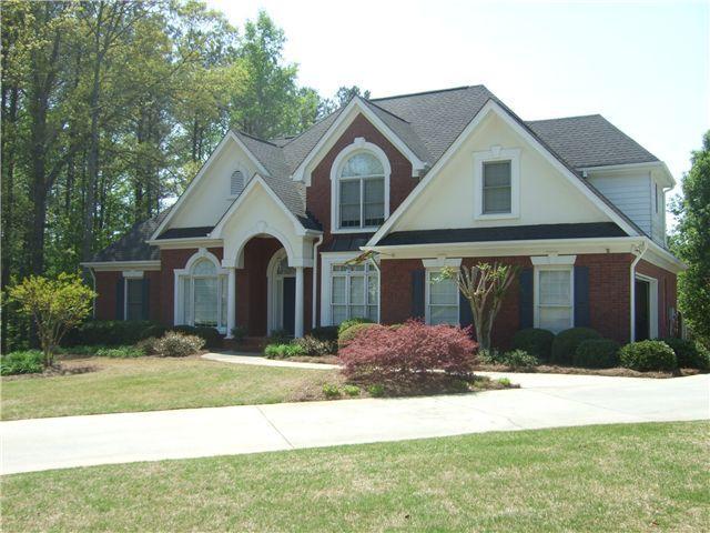 Red brick cream stucco white trim black blue shutters for Stucco and brick homes