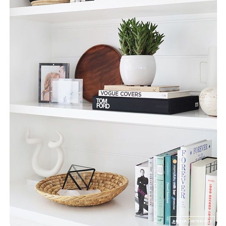 Today's #stagingsaturday tip: when staging a bookshelf don't be afraid to layer objects in front of one another at varying heights and use decor pieces mixed with  standing up or stacked (a combo of alternating book stacks per shelf is very eye-pleasing). Blank space between featured items is ! #homedecor #interiordesign #roominspo #staging #bedroom #livingroom #dining #buylocal #shoplocal #shopcalgary #shopyyc #yyc #17thAve #bookshelf #robertsweep
