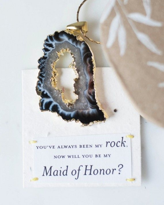 """The maid of honor role is no small feat. It takes a certain level of knowledge about you (the bride), a knack for disaster management, and the know-how to plan a couple of great parties—which, let's admit it—are qualities she already has, and the reason she's your #1. Therefore, requesting her to take on the MOH duties should be done in a personalized way that'll touch both your hearts and fuel both of your excitement levels for your big day. Here is some MOH """"proposal"""" inspiration to make…"""