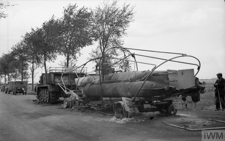 The remains of a German midget submarine, abandoned by the roadside by retreating German forces near Arras, France.